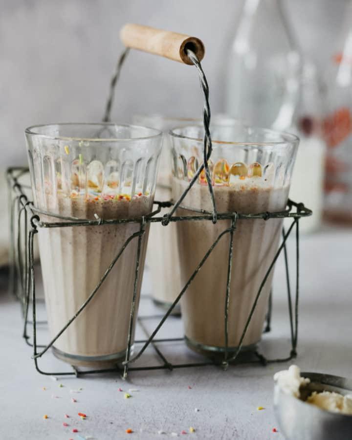 Three glasses with birthday cake milkshake