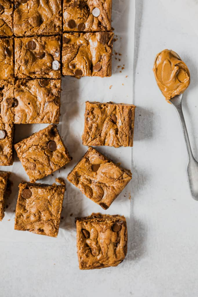 cookie butter bars with a spoonfull of cookie butter