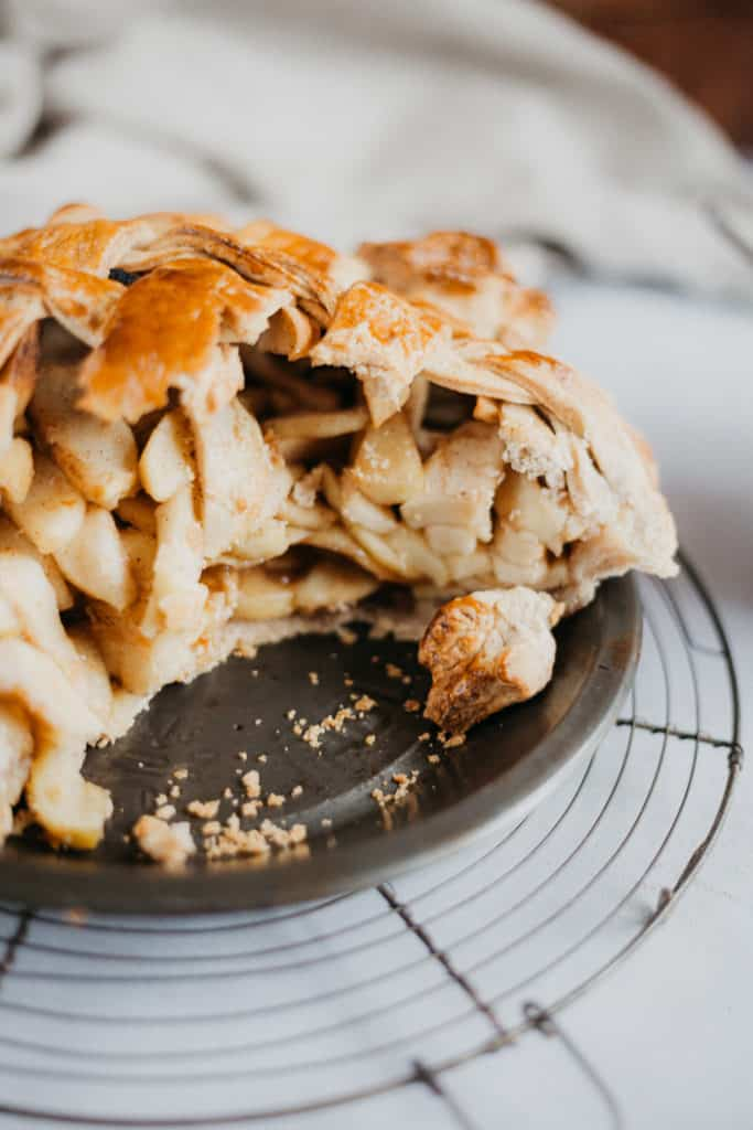 image of apple pie with several slices taken out