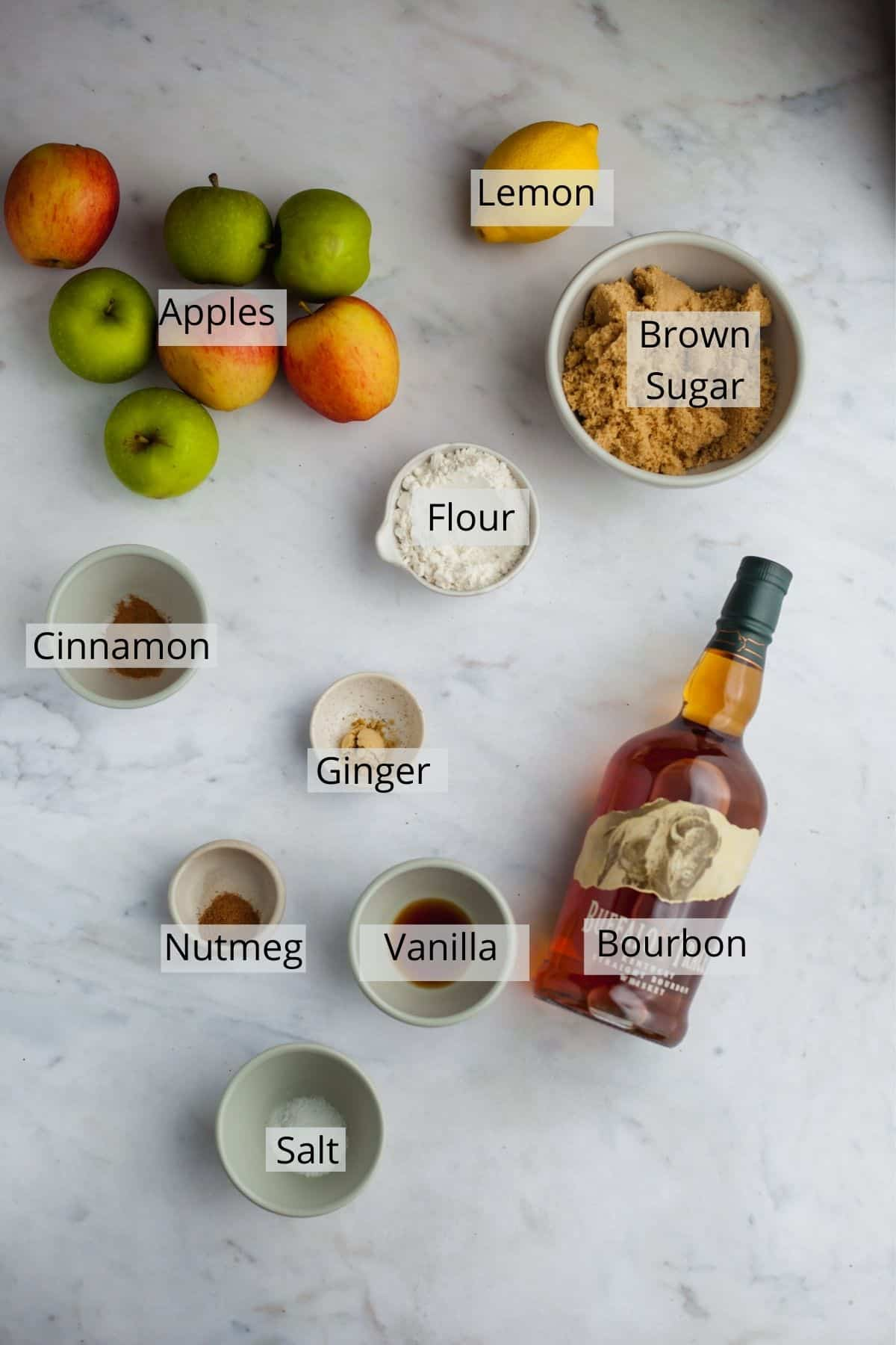 ingredients needed for bourbon apple pie in small bowls