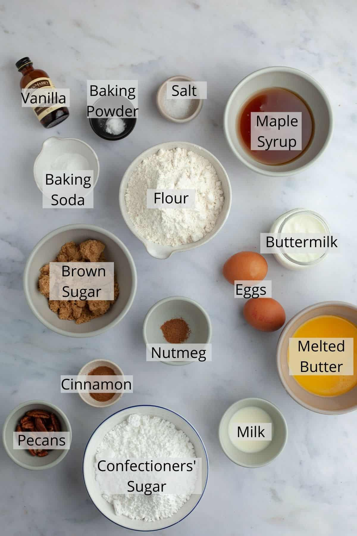 ingredients for maple glazed donuts in a variety of small bowls