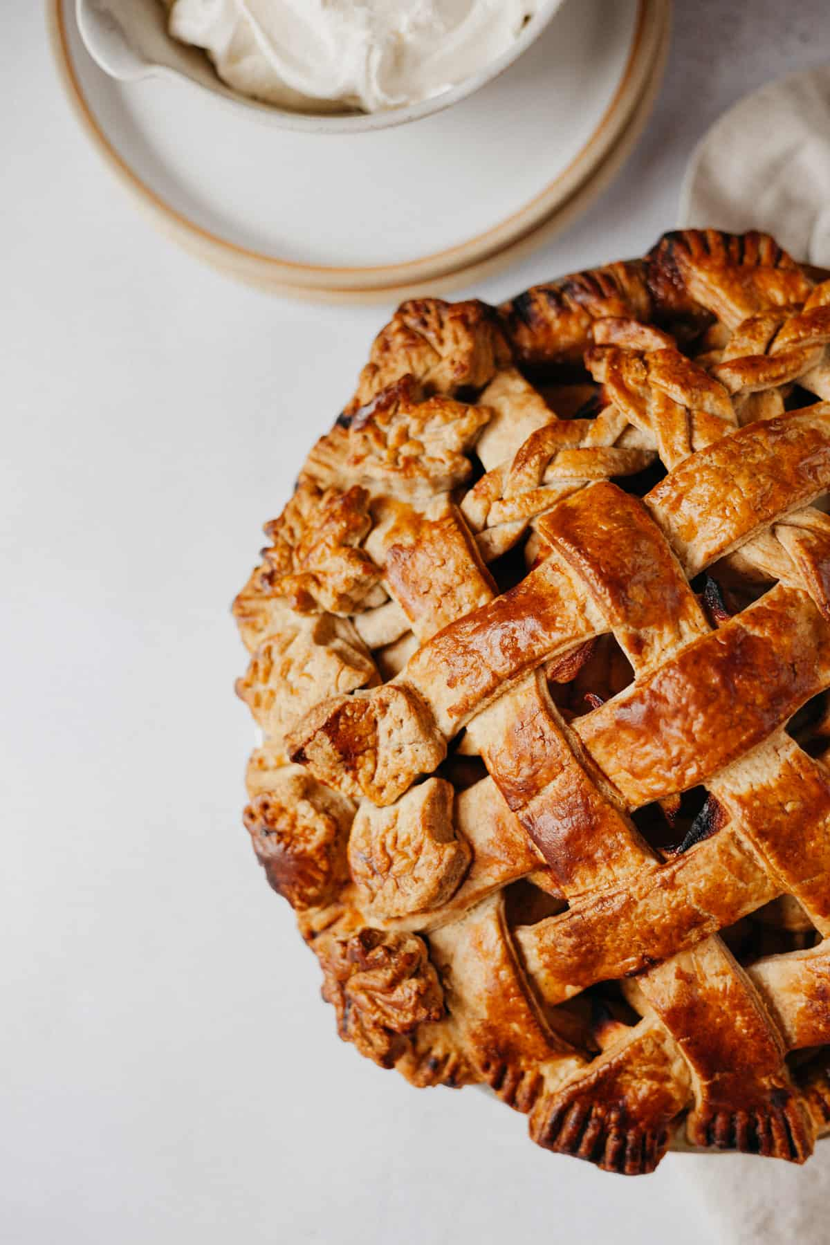 A close up of a pie with a lattice top