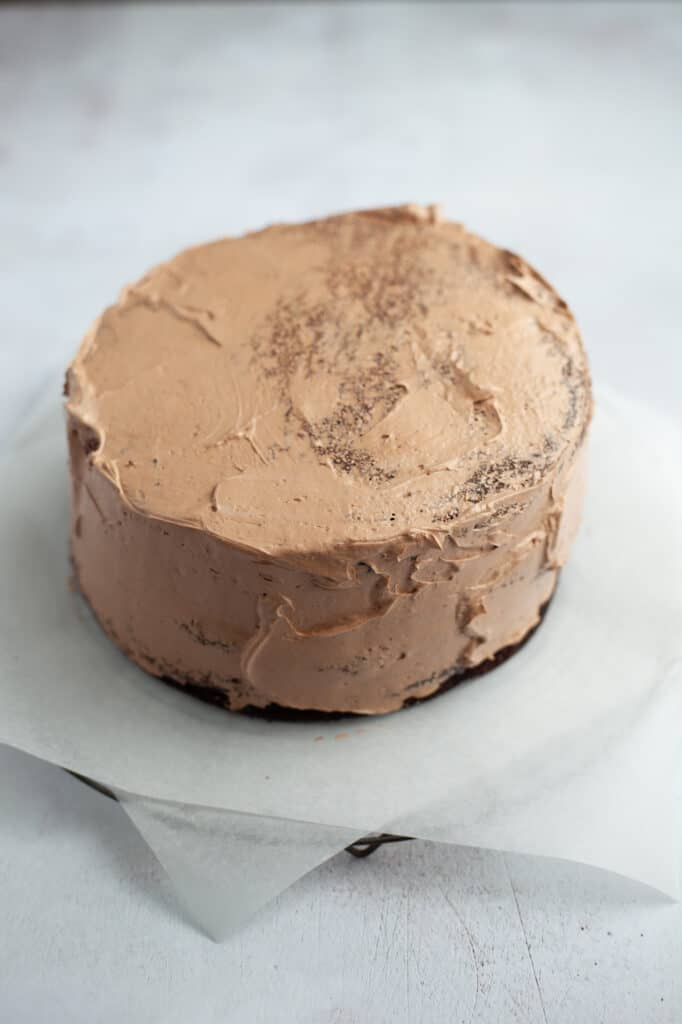 A chocolate cake with a chocolate crumb coat.