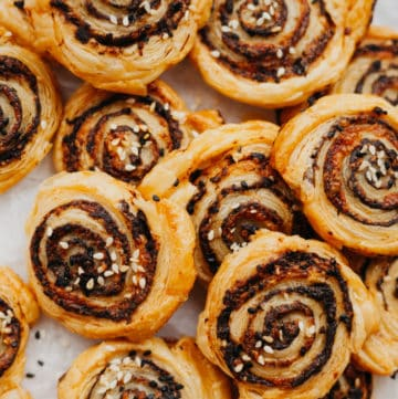 sesame and tapenade puff pastry pinwheels