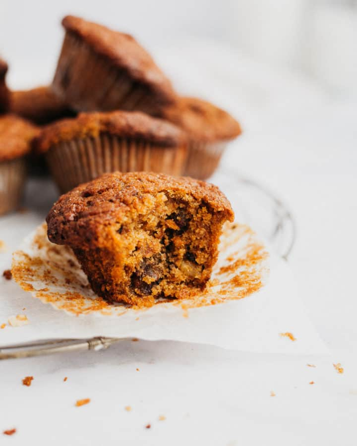 an apple and carrot muffin with a bite taken out of it