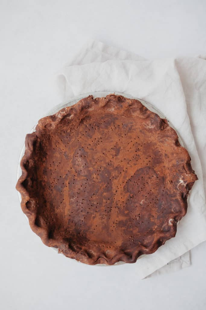unbaked chocolate pie crust in a pie plate