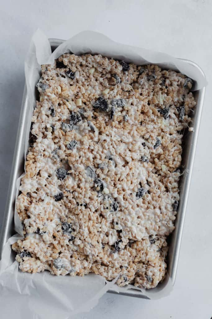 A 9x13 inch baking pan filled with rice krispie treat batter