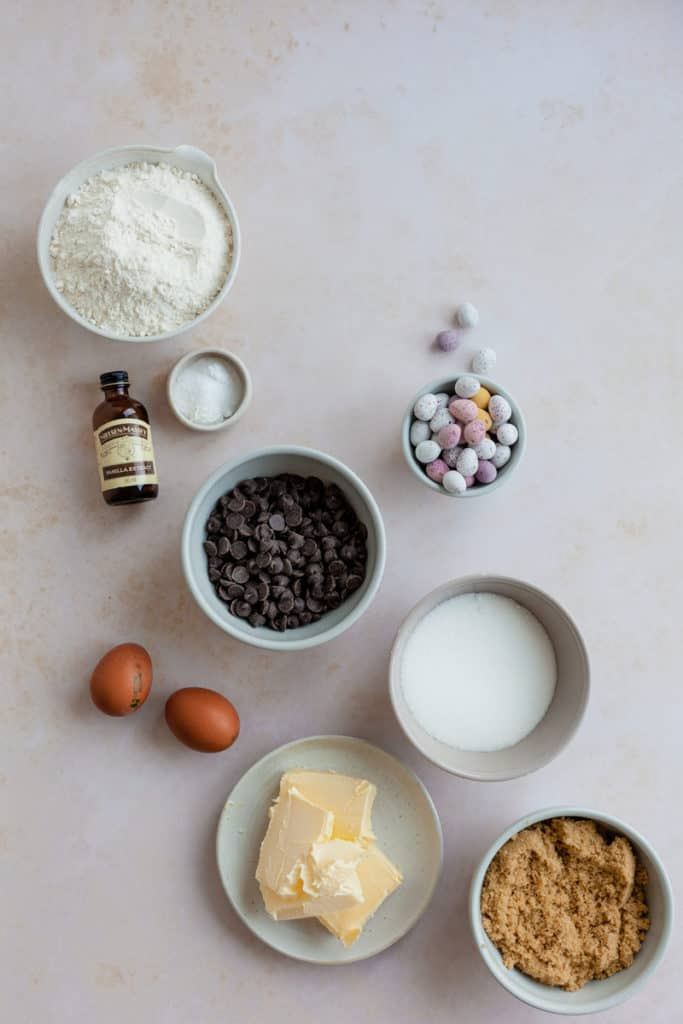 All the ingredients needed for mini egg cookies, in their own small bowls.