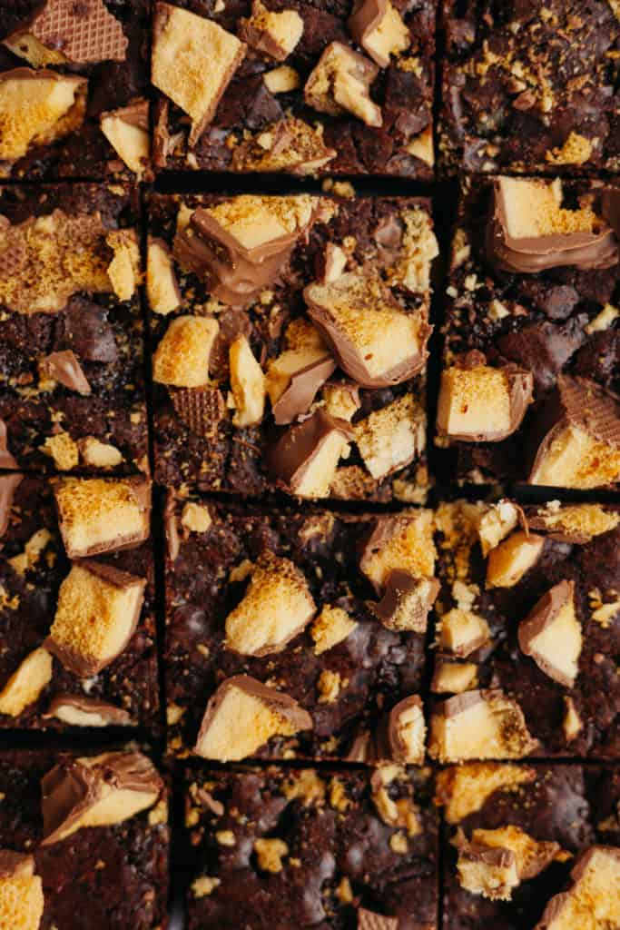 A close up of honeycomb brownies that have been cut into squares