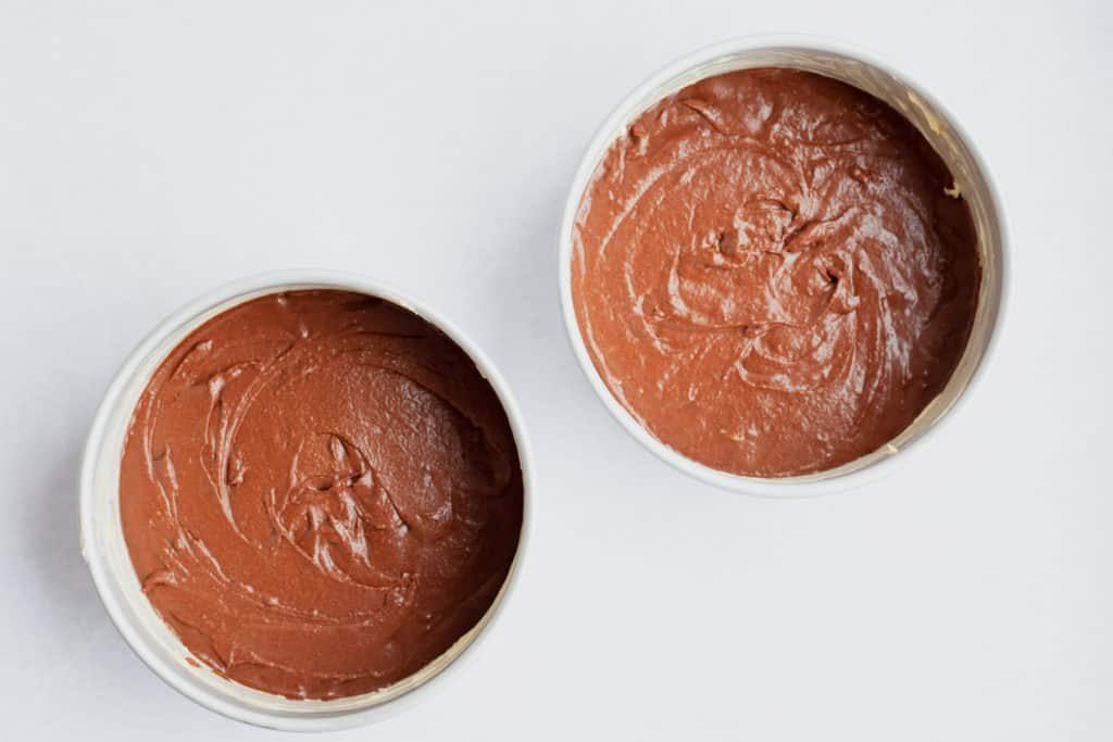 Two cake tins with unbaked cake batter