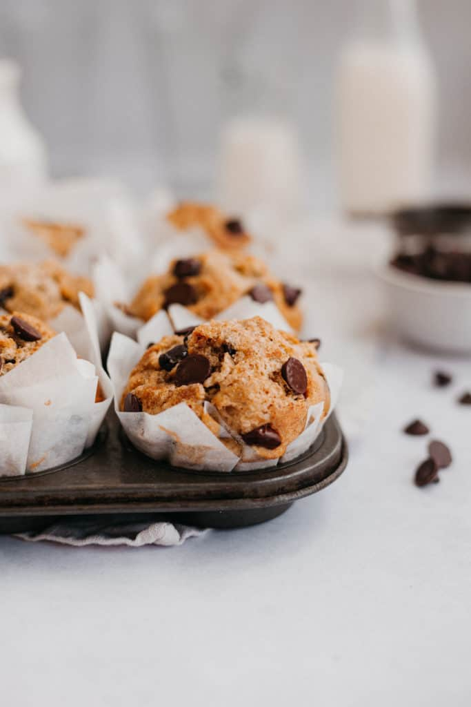 banana oatmeal muffins with chocolate chips in a dark muffin pan