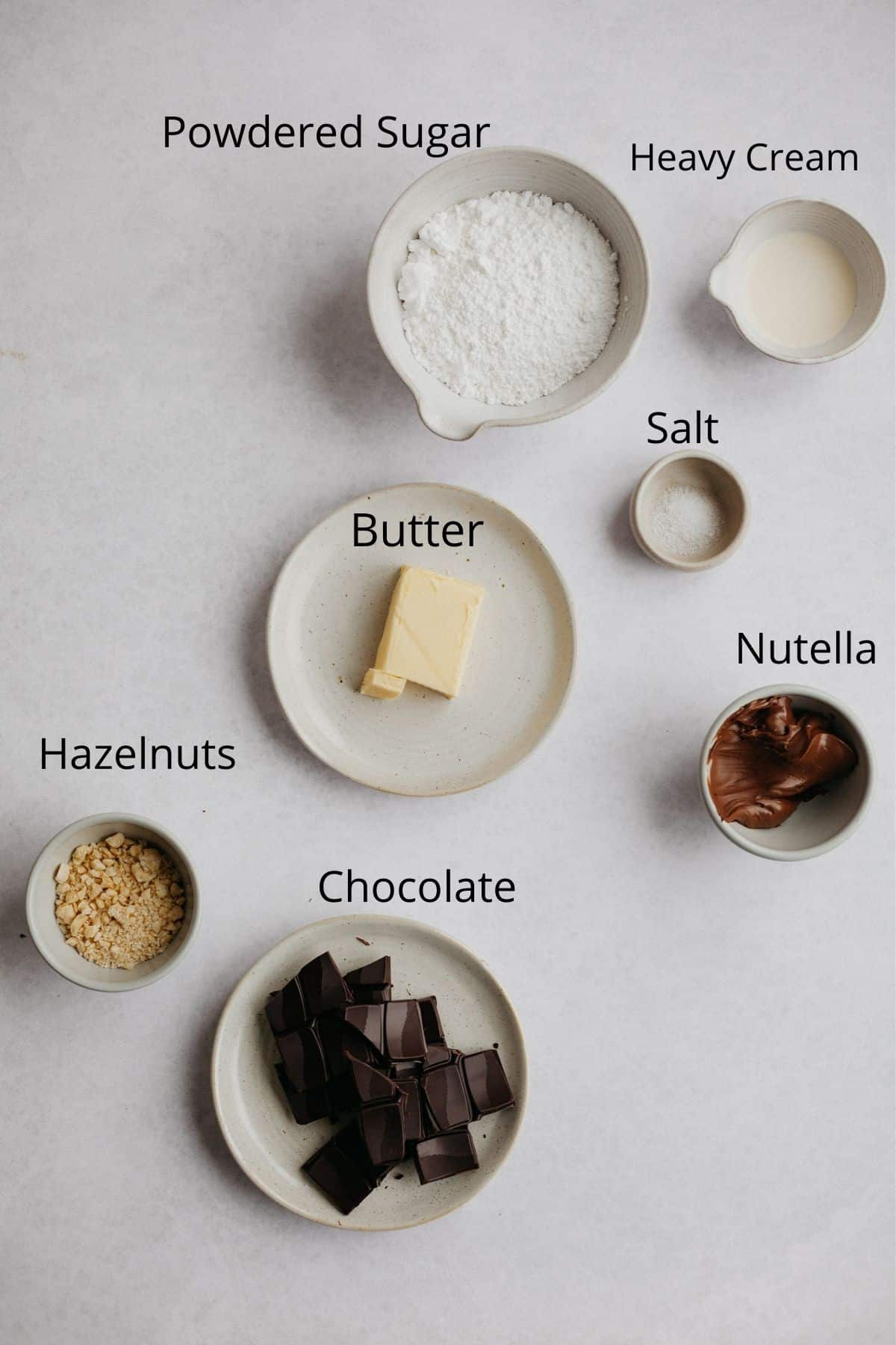 An overhead shot of all the ingredients for nutella buttercream filling
