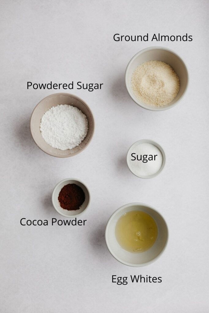 An overhead shot of ingredients for chocolate macaron shells