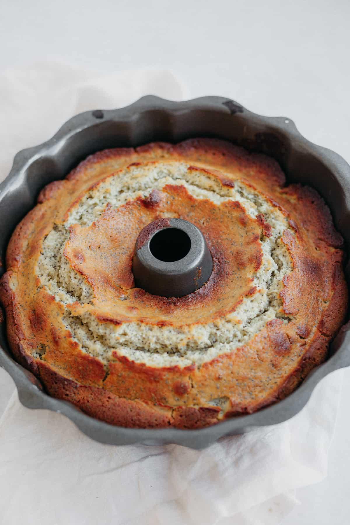 A bundt cake pan with a baked lemon seed cake