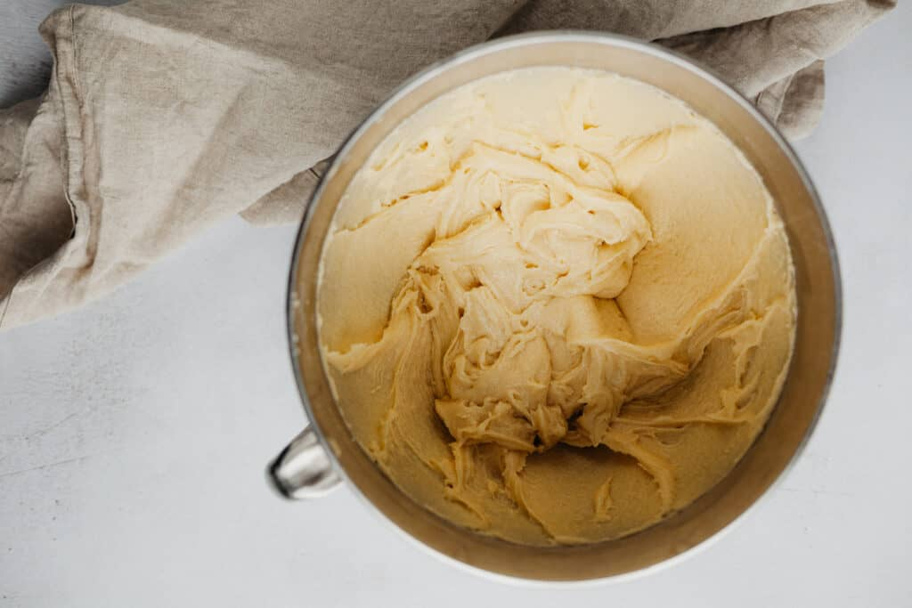 Vanilla cake batter in a silver bowl