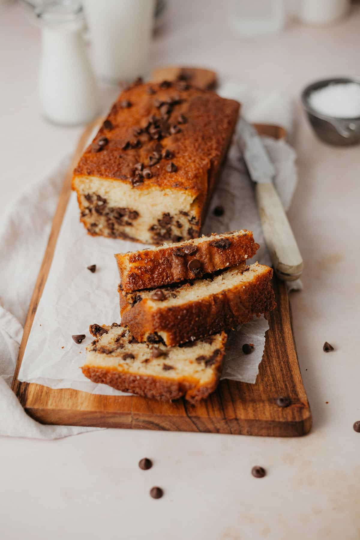 A chocolate chip loaf cake, three slices have been made.
