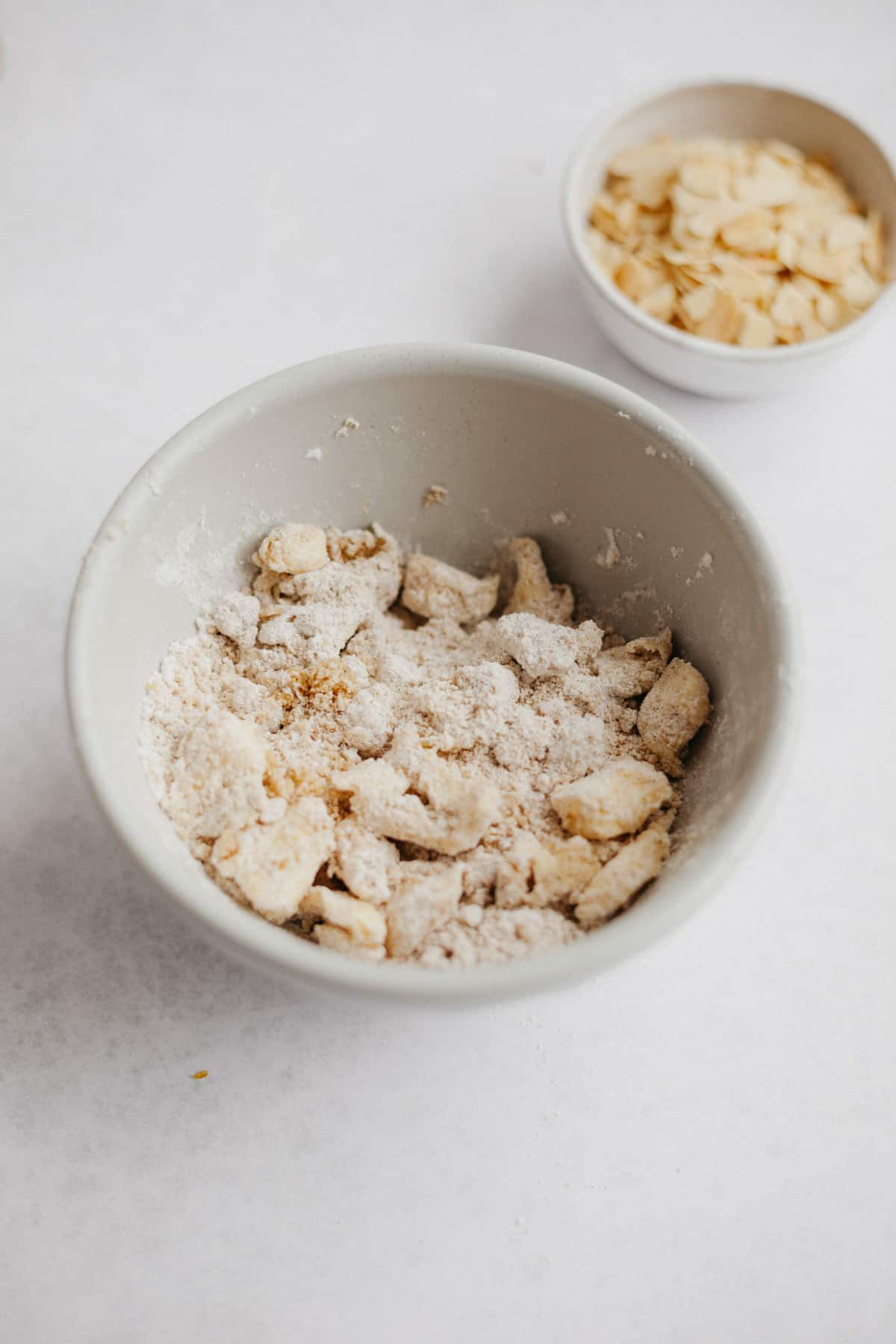 The ingredients for a crumble topping in a small grey bowl