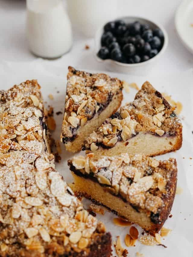 Three slices of blueberry crumb cake with flaked almonds on top