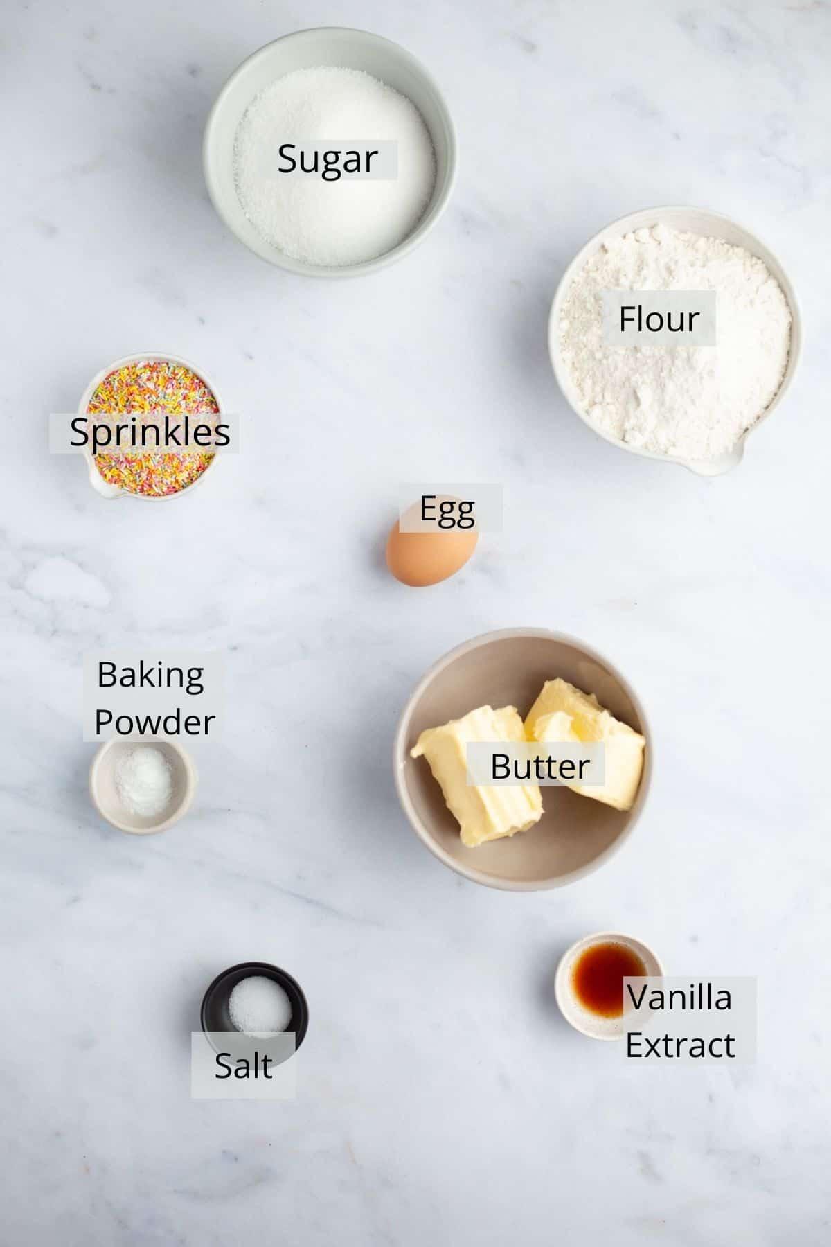 An overhead shot of ingredients for sprinkle sugar cookies