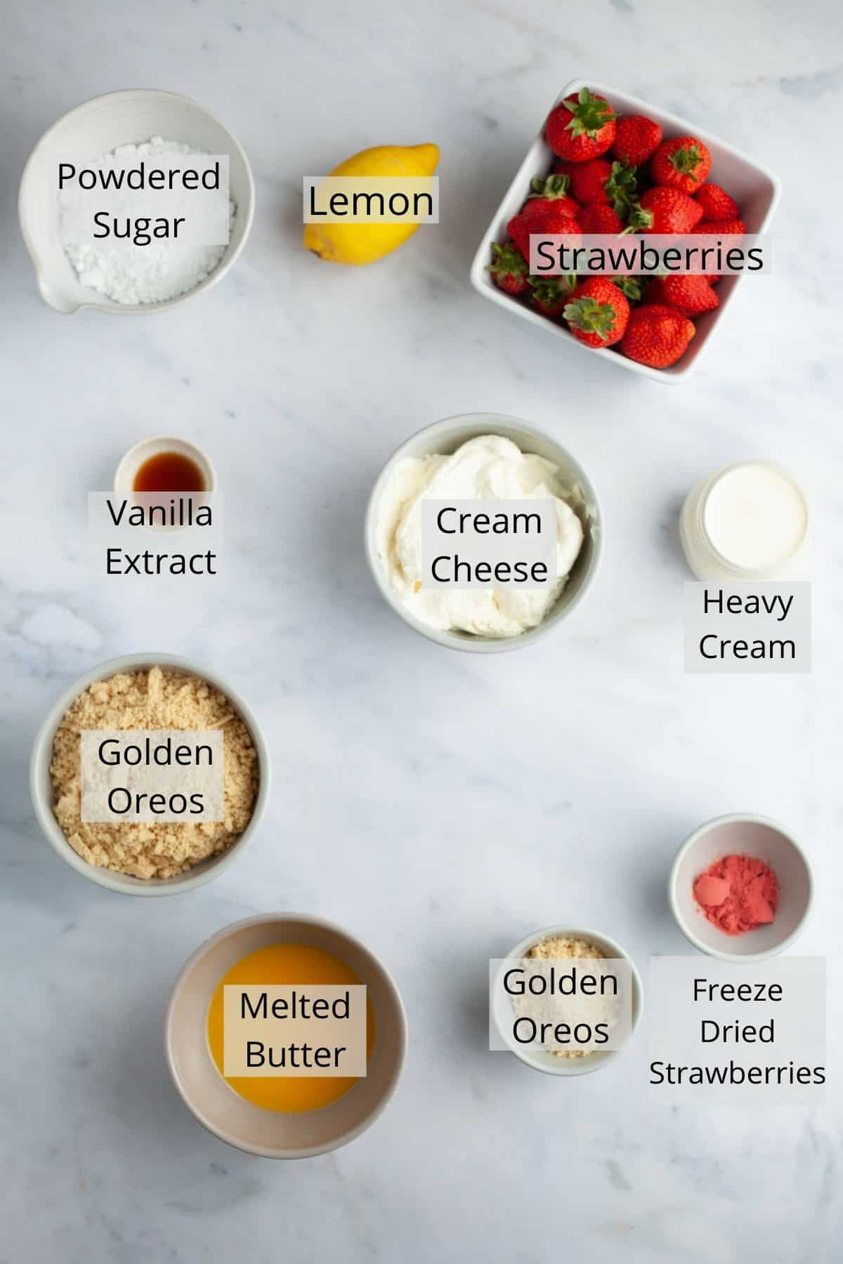 An overhead shot of ingredients for strawberry crunch cheesecake