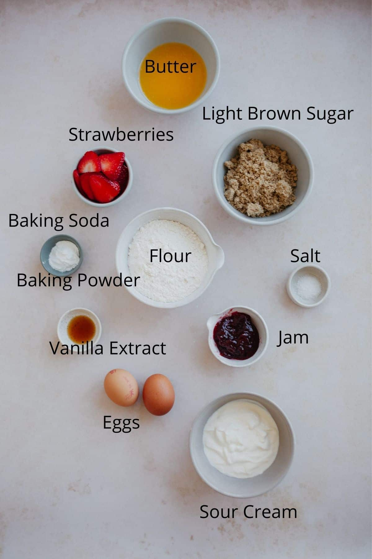 An overhead shot of the ingredients for strawberry cake