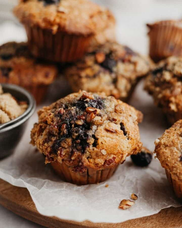 Banana blueberry oatmeal muffins on parchment paper