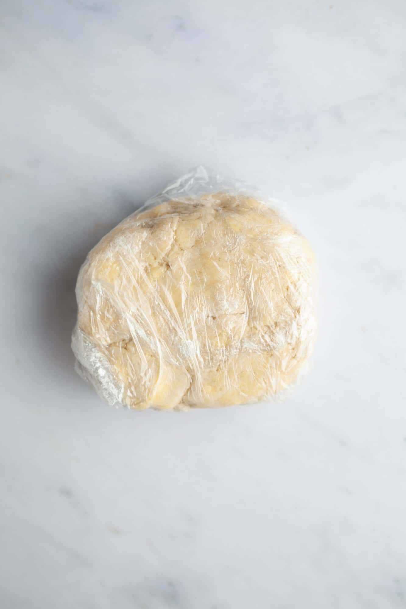 Pie dough wrapped in plastic wrap