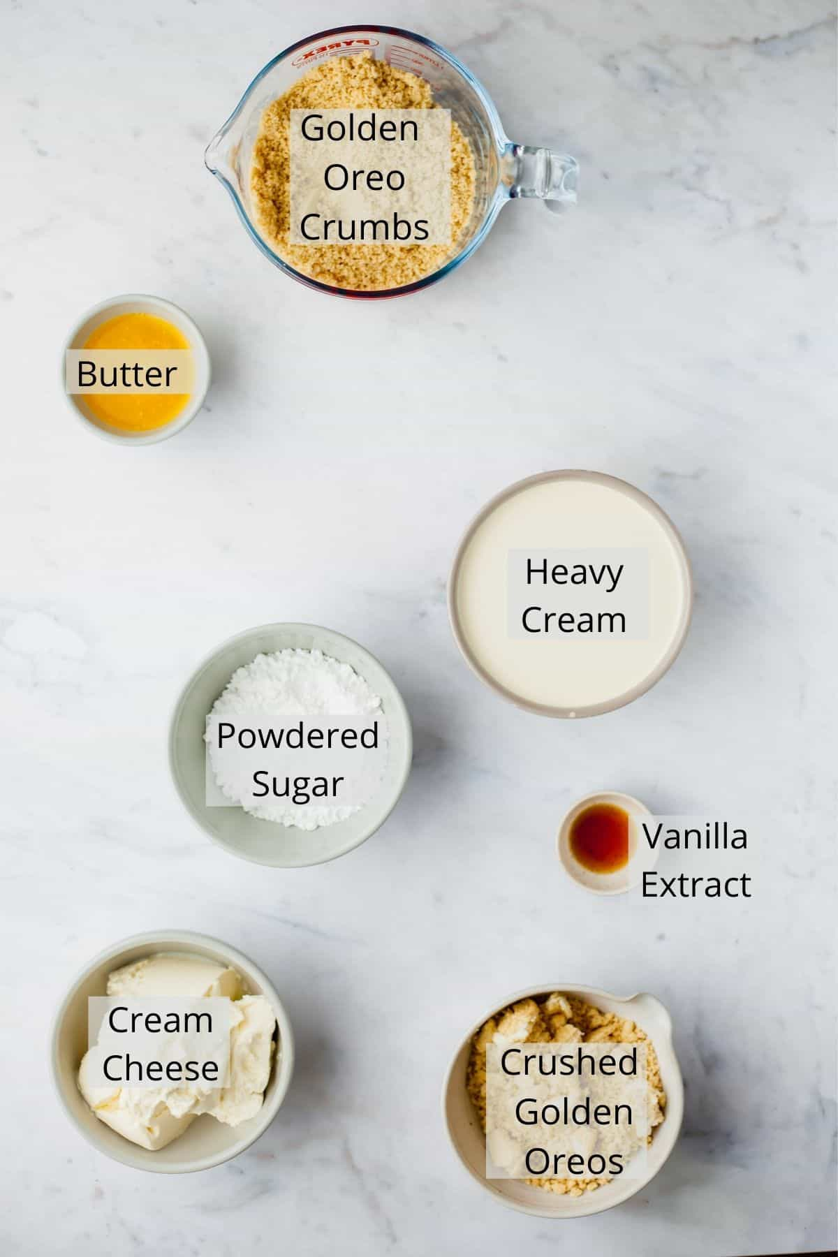 An overhead shot of ingredients needed for golden oreo cheesecake