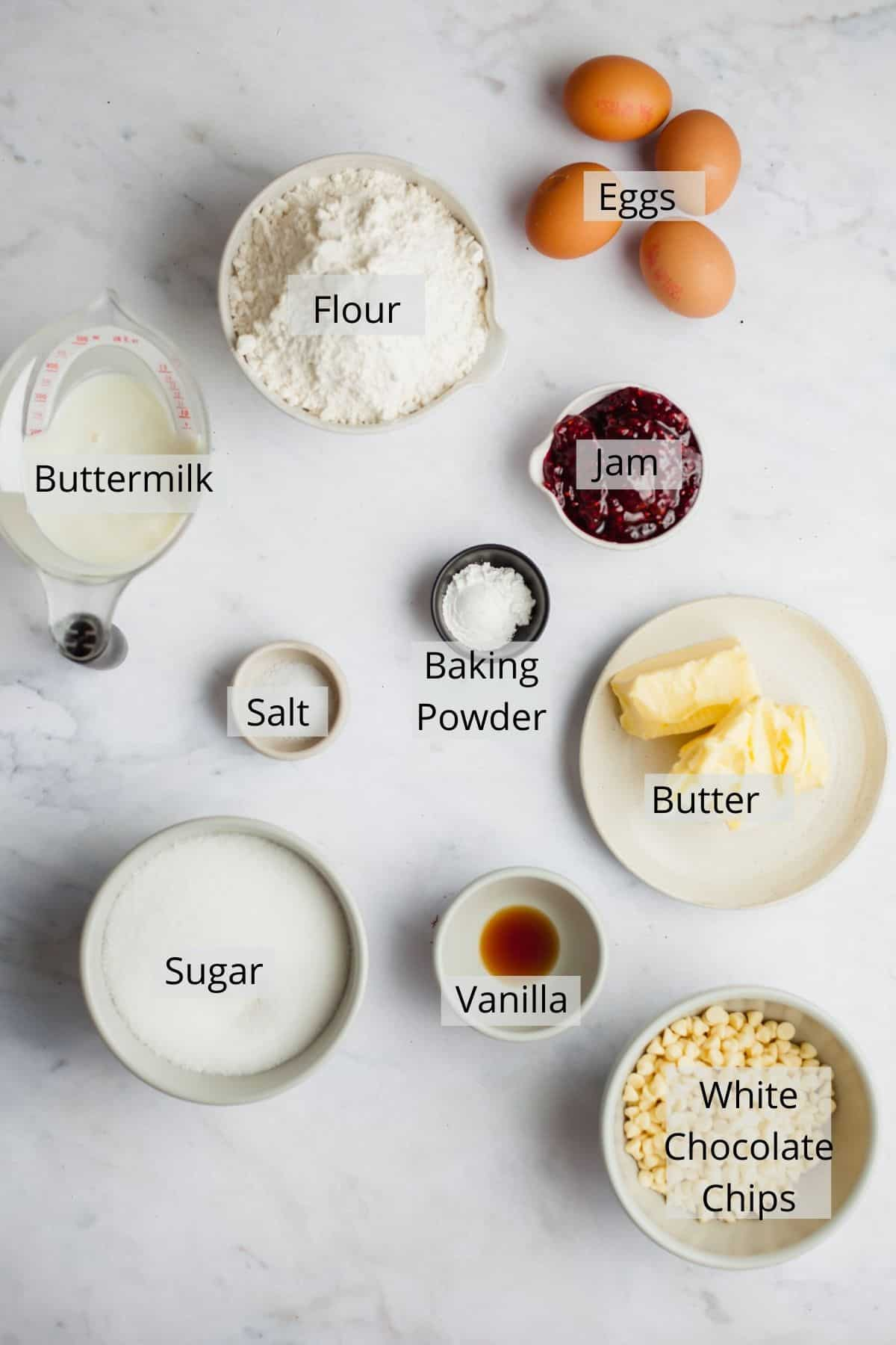 An overhead shot of ingredients needed for white chocolate and raspberry bundt cake