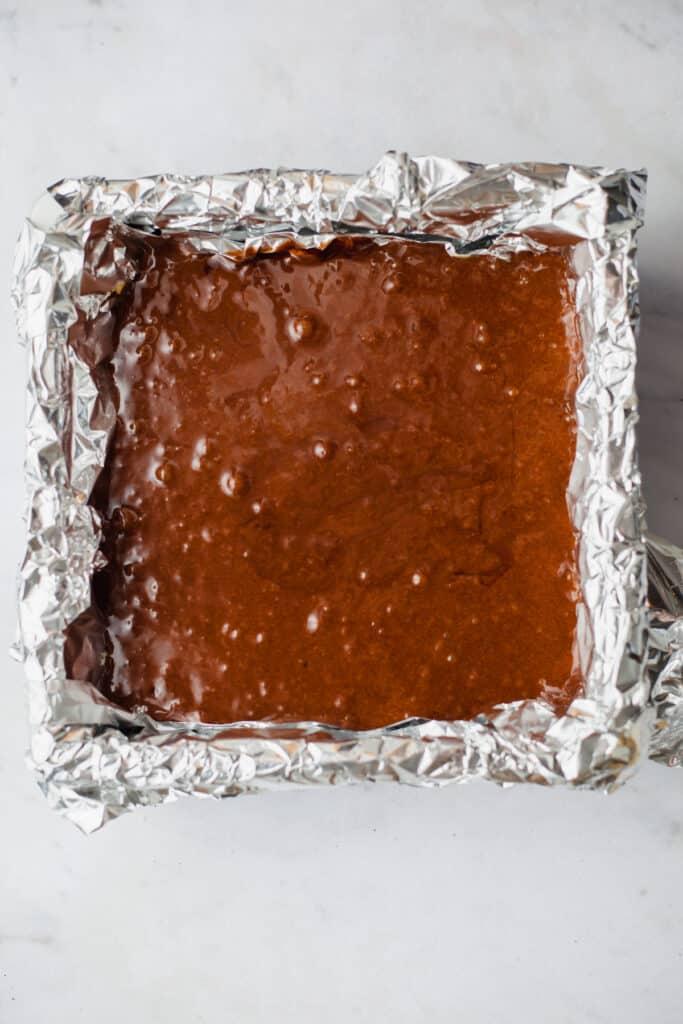 Brownie batter in a brownie pan