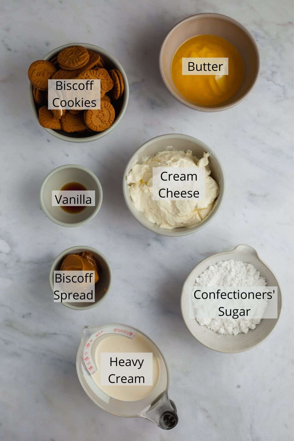 overhead shot of ingredients needed for biscoff cheesecake