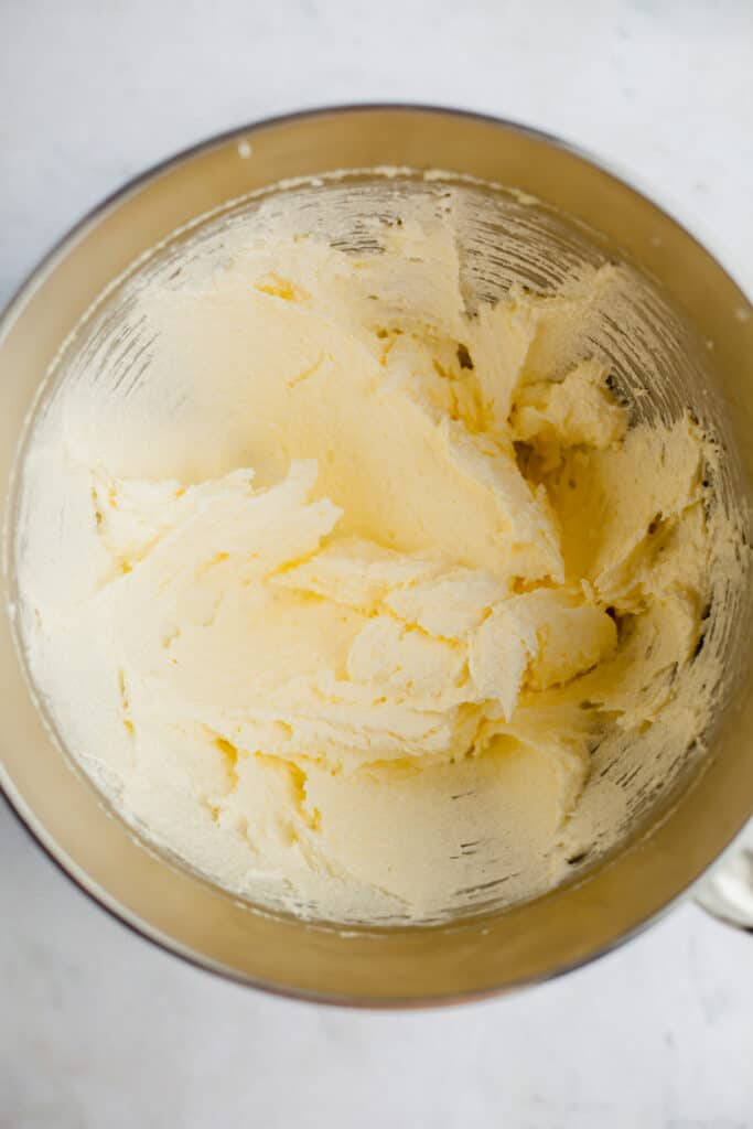 creamed butter and sugar in a silver mixing bowl