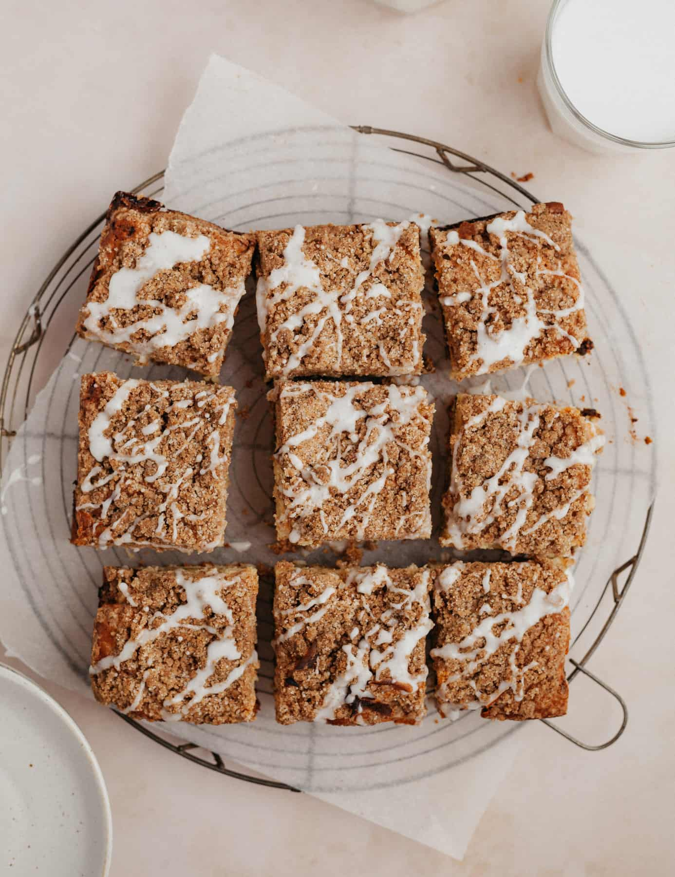 An overhead shot of 9 slices of coffee cake on a wire cooling rack