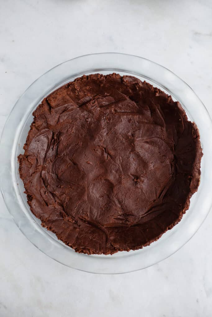 chocolate cookie crust pressed into a pie pan