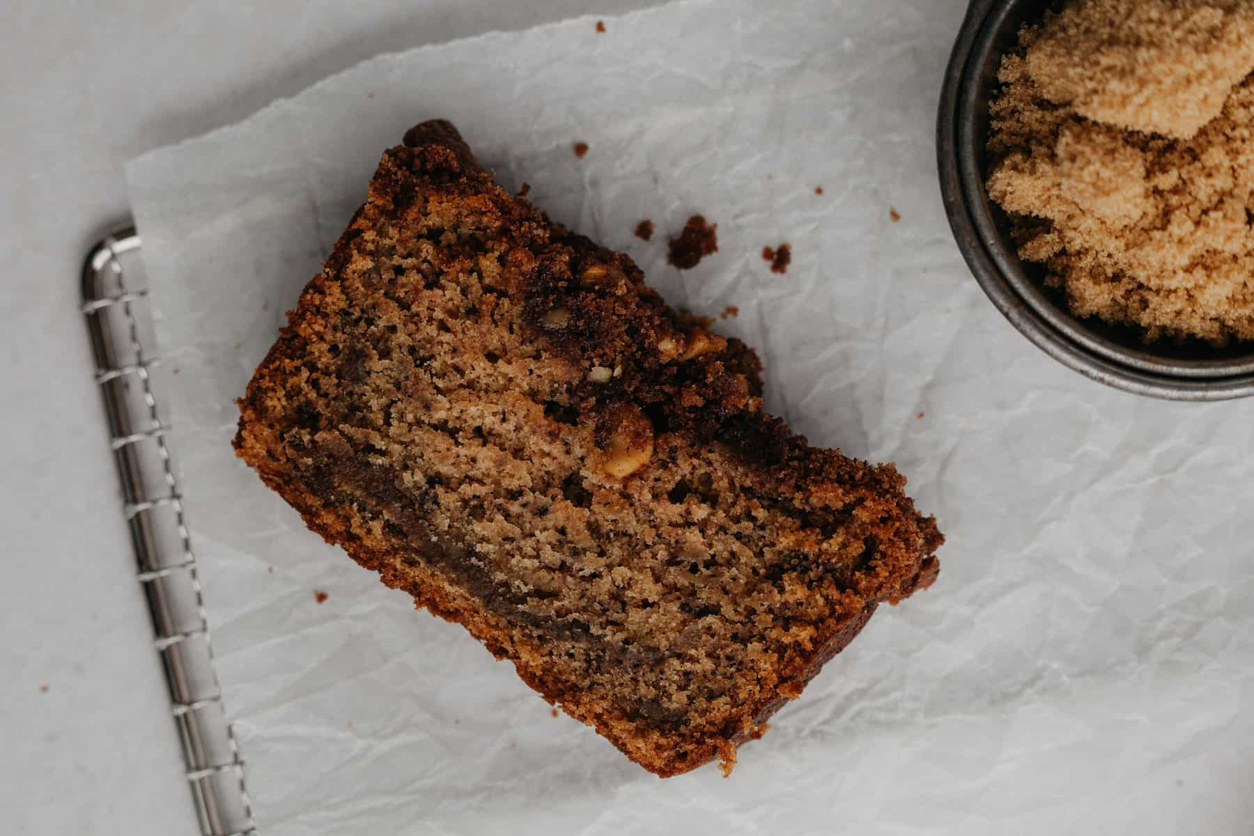 A slice of cinnamon crunch banana bread on parchment paper