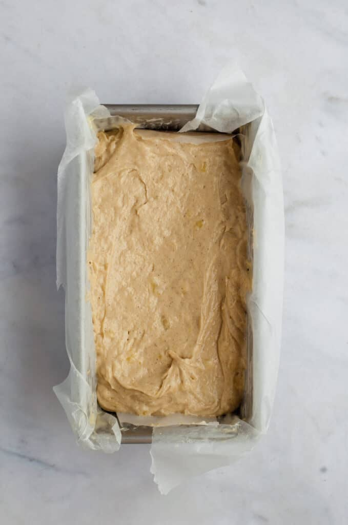 unbaked banana bread in a loaf pan