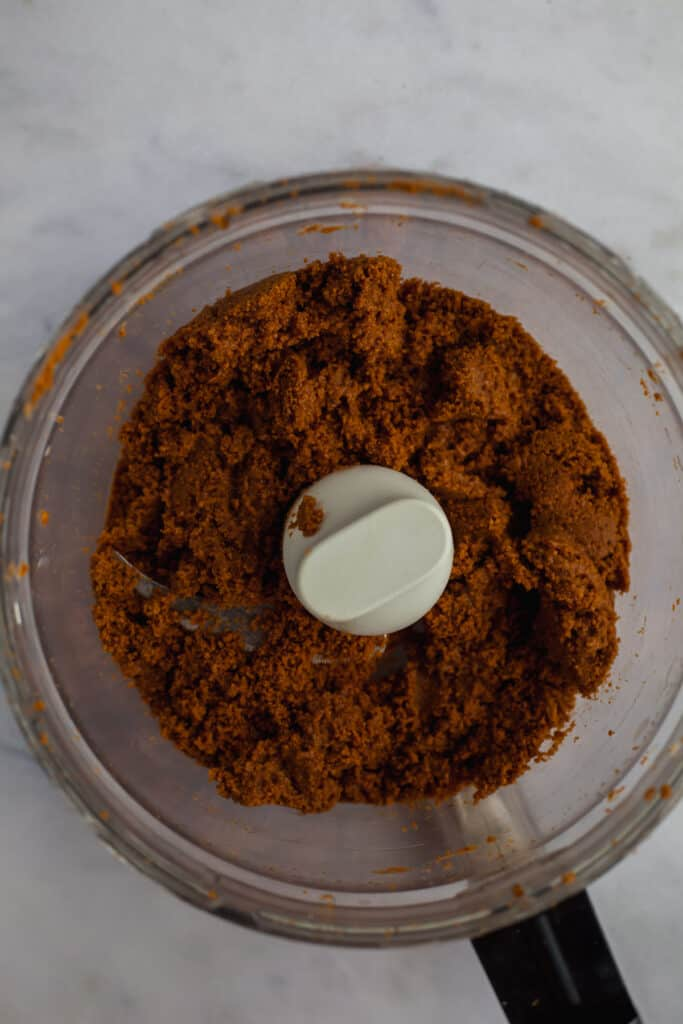 food processor with biscoff cookie crumbs and melted butter