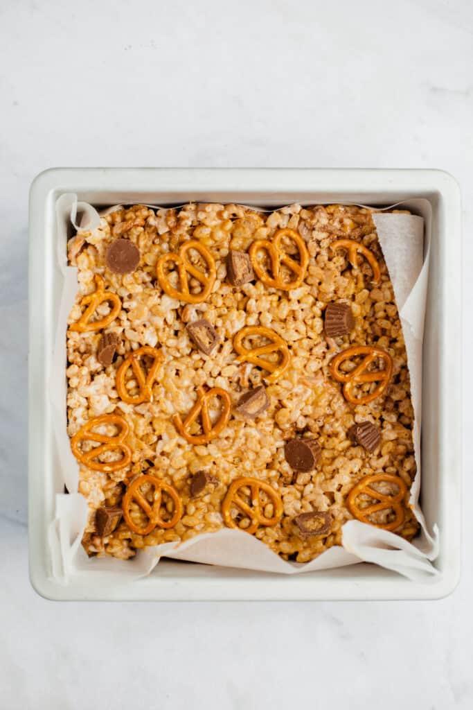 Peanut butter rice krispie treats in a metal square pan