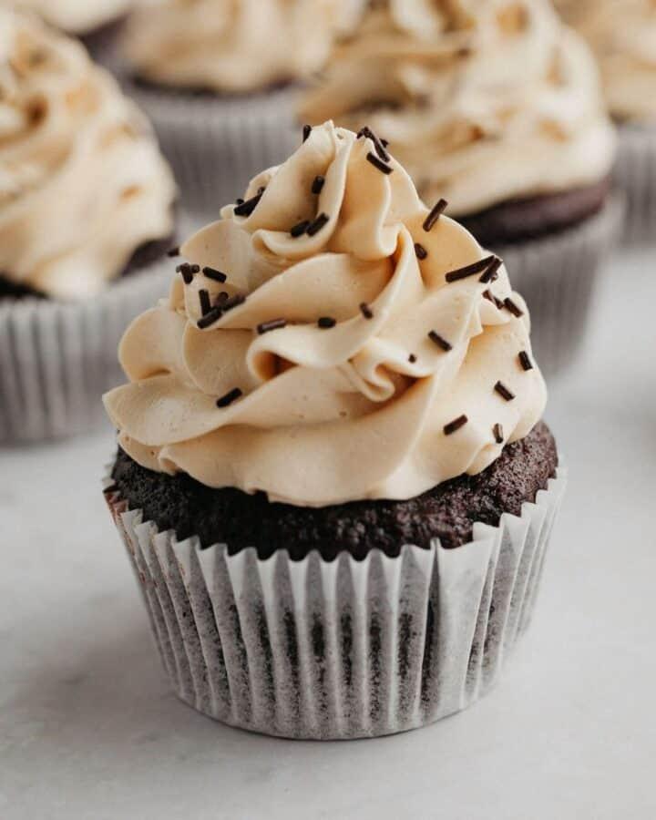 A close up of a mocha espresso cupcake