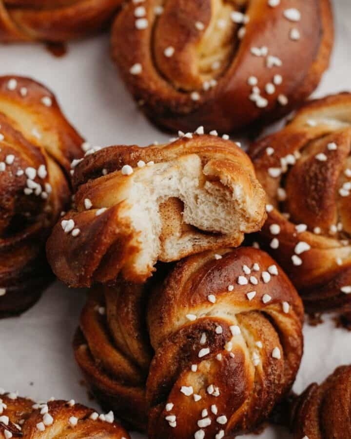 Close up of a swedish cinnamon bun with a bite taken out of it