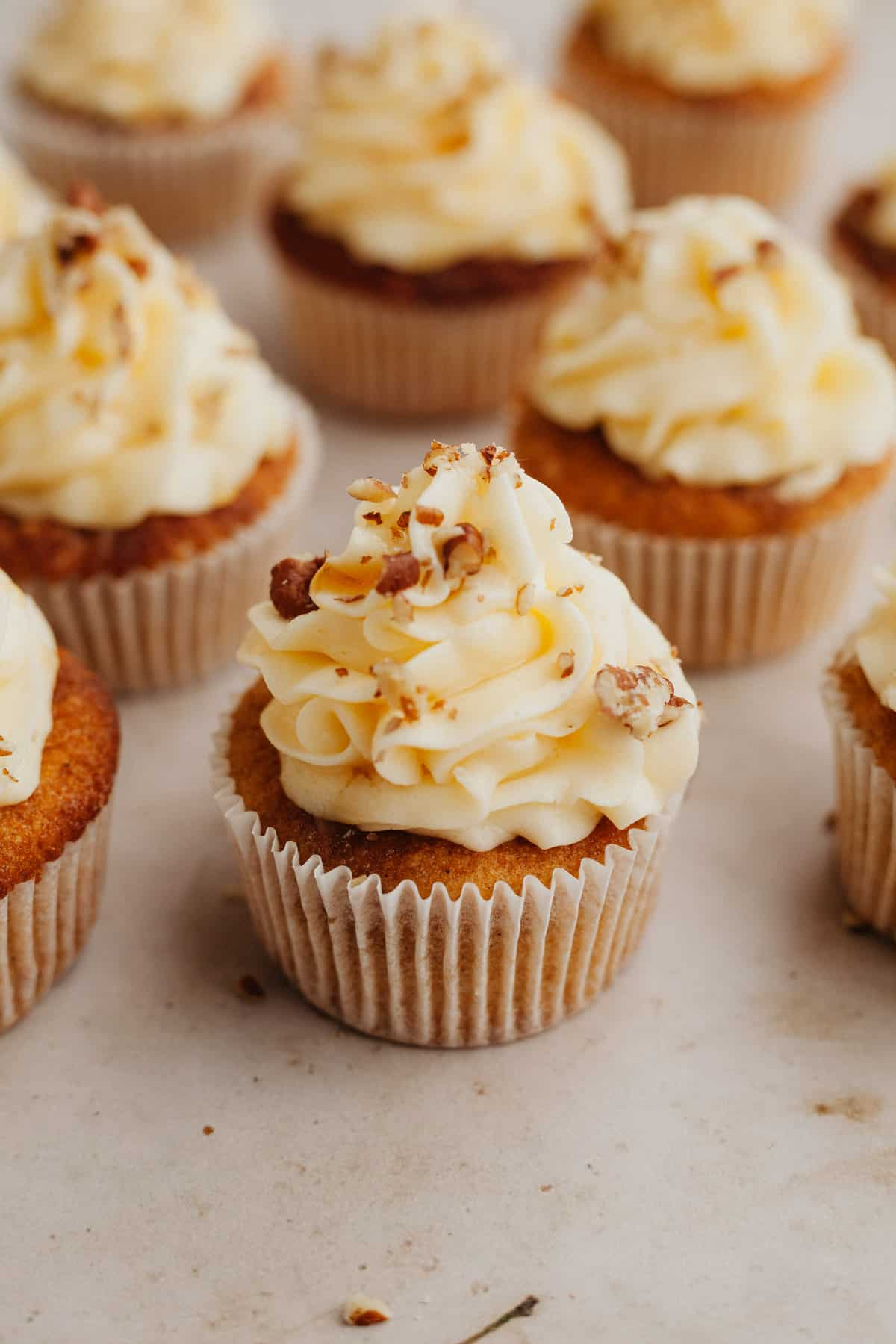 Several maple cupcakes with frosting on top