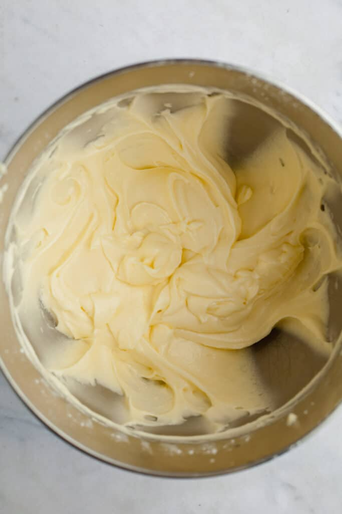 A silver mixing bowl with mascarpone buttercream