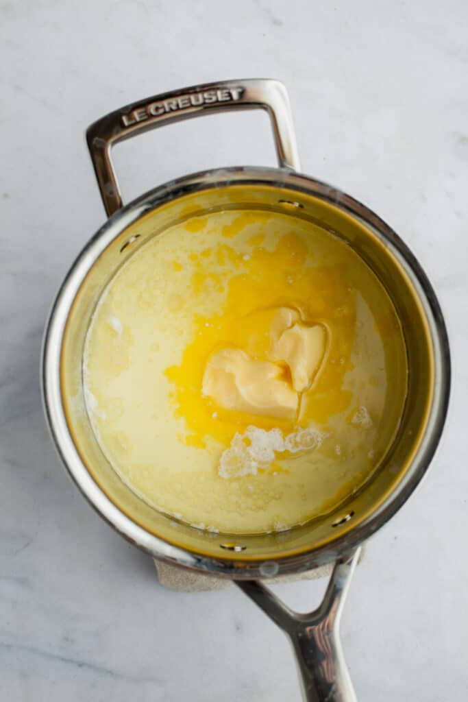 A small saucepan with melted butter and milk