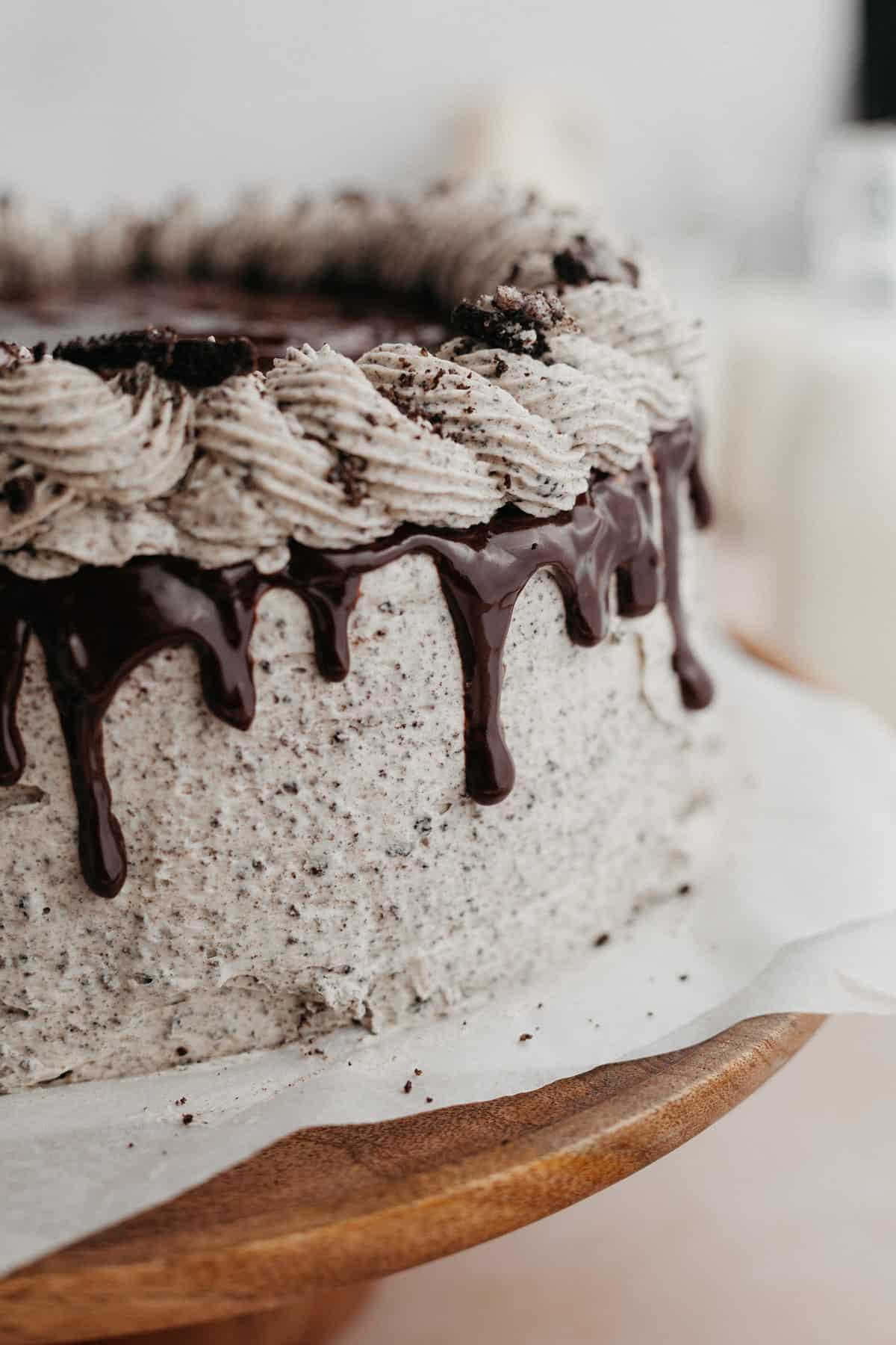 A close up of an oreo drip cake