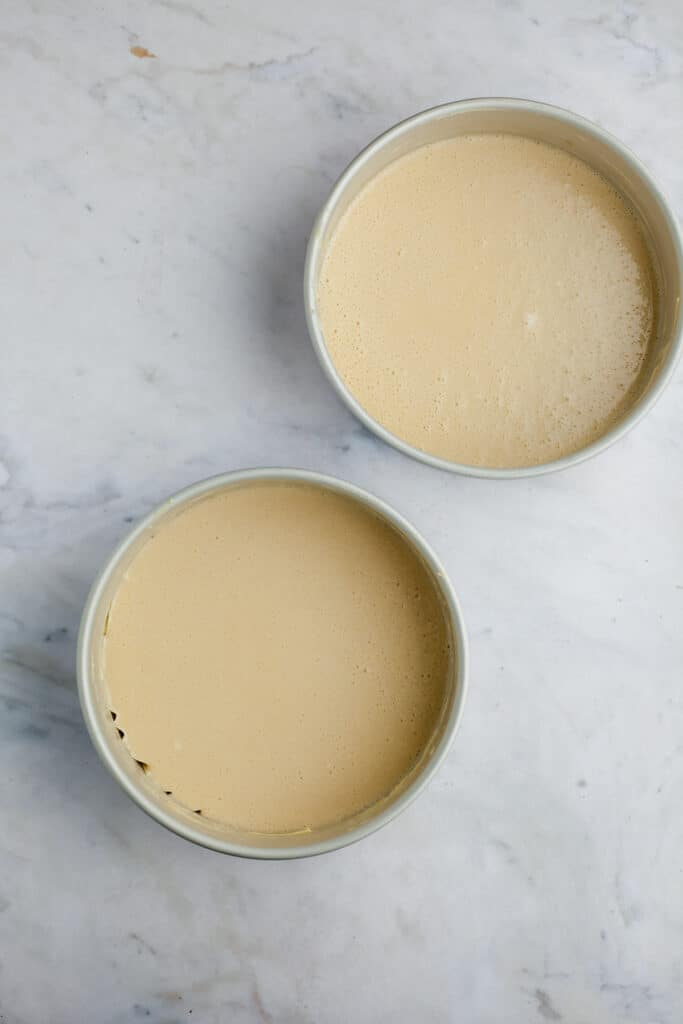 two cake pans with unbaked cake batter