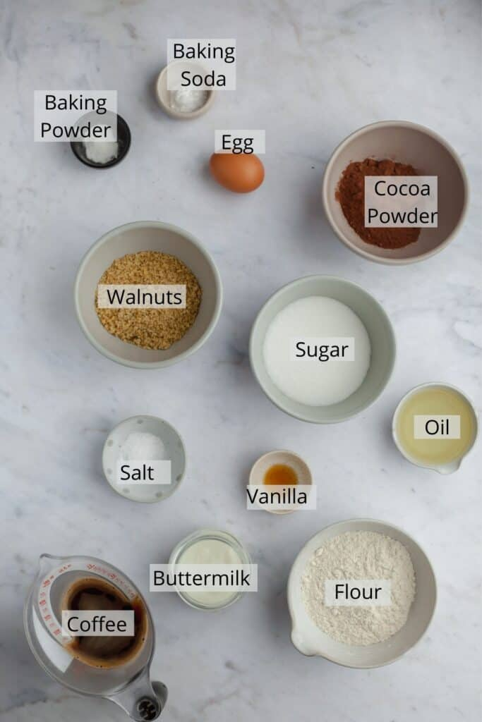 the ingredients for chocolate walnut cake weighed out into various small bowls