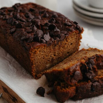 A close up of a pumpkin banana loaf with several slices cut
