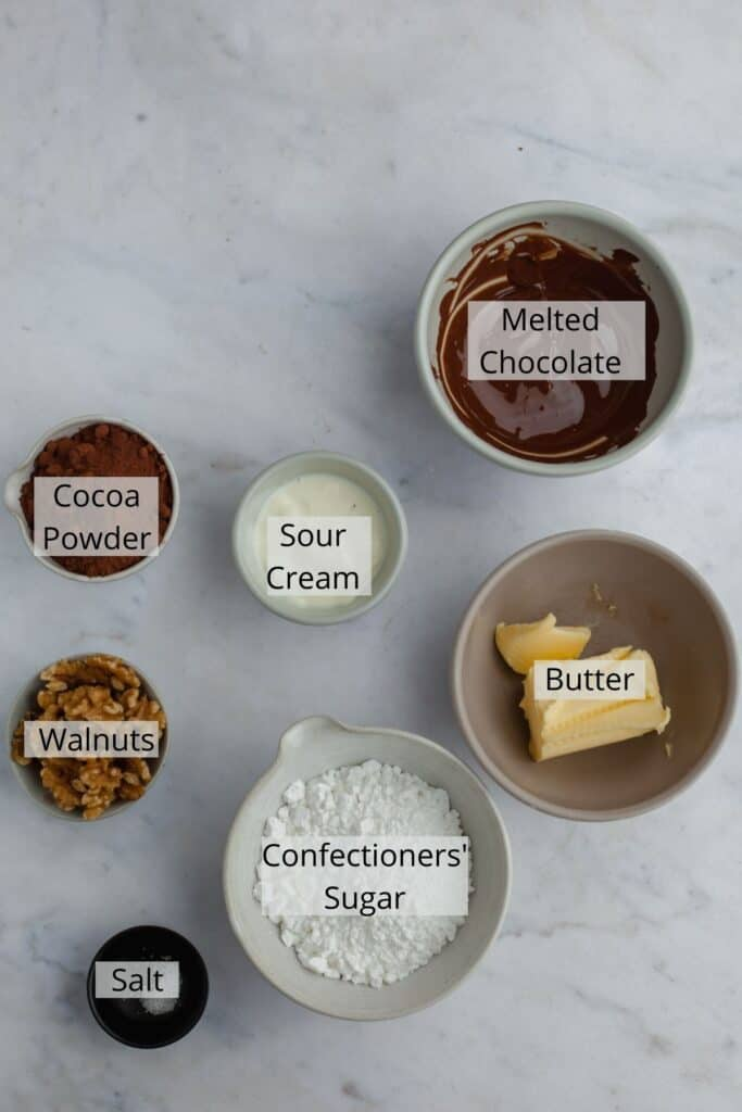 ingredients for chocolate walnut frosting weighed out into bowls