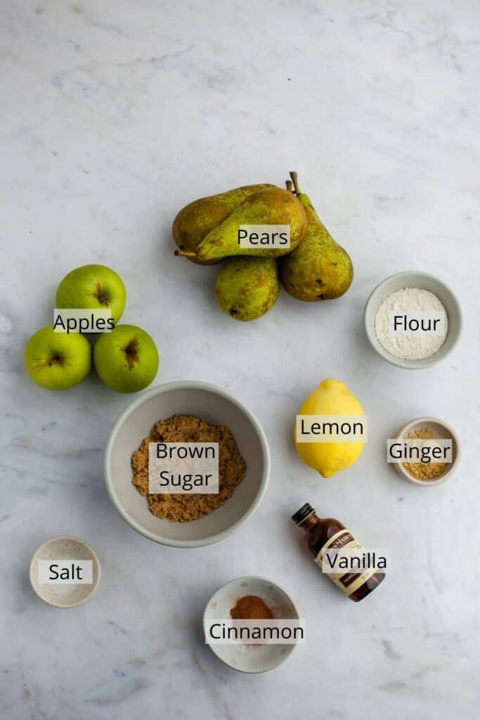 All the ingredients needed for pear and apple crisp weighed out into small bowls.
