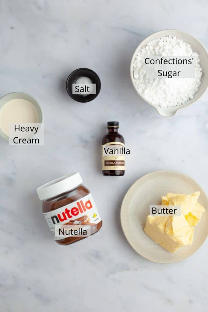 ingredients for nutella frosting weighed out into small bowls.